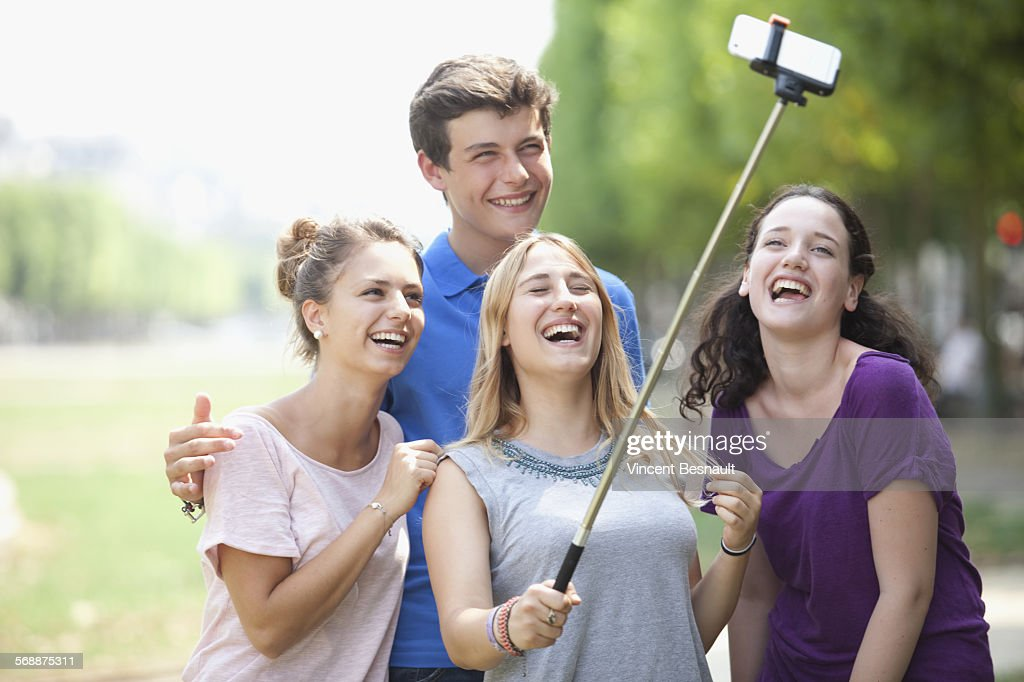 Group of four teenagers making a selfie : Stock Photo