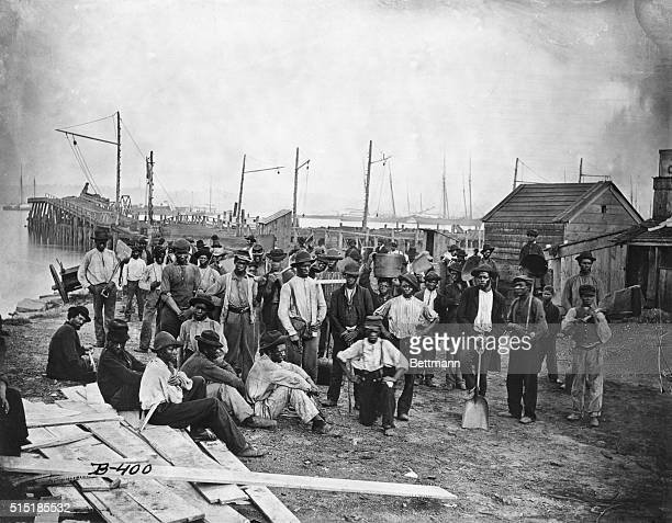 Group of freed African American slaves along a wharf during the United States Civil War.