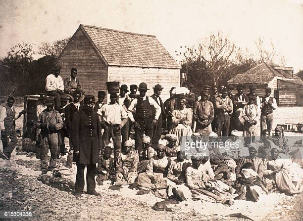 A group of freed slaves gather on the plantation of Confederate General Thomas F Drayton in Hilton Head South Carolina during the Union occupation of...