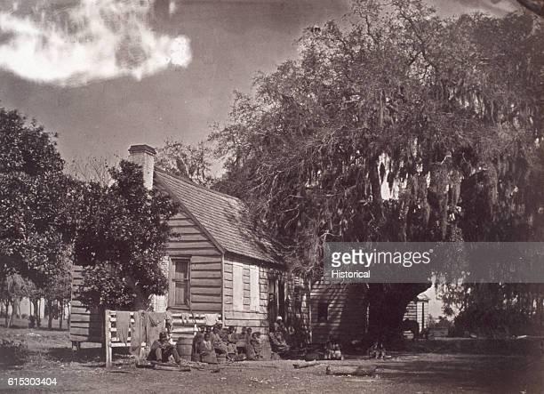 A group of freed slaves outside slave quarters on the Elliot Plantation Hilton Head South Carolina