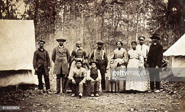 Group of freed slaves who worked as laborers and servants with the 13th Massachusetts Infantry Regiment during the American Civil War, 1862.