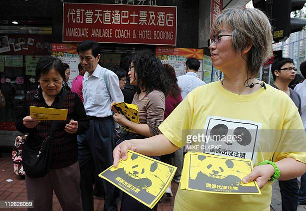 A group of freedom advocates hand out leaflets asking people to be aware of their safety in China outside a travel agents in Hong Kong on April 20...