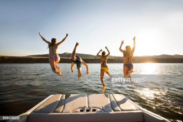a group of freinds enjoying a day at the lake - four people stock pictures, royalty-free photos & images