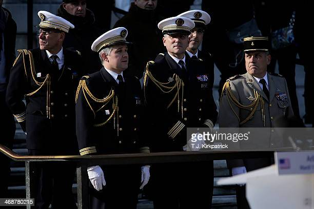 A group of French military officers stand in the audience awaiting the arrival of French President Francois Hollande for a ceremony at the Tomb of...
