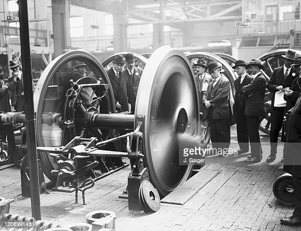 A group of French railway officials watching a wheeltesting machine in operation during a visit to the GWR works at Swindon Wiltshire 8th May 1929