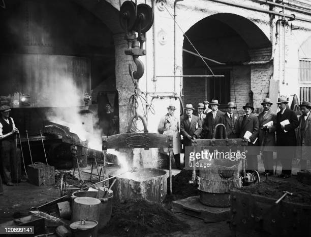 A group of French railway officials watching whitehot metal running from the foundry during a visit to the GWR works at Swindon Wiltshire 8th May 1929