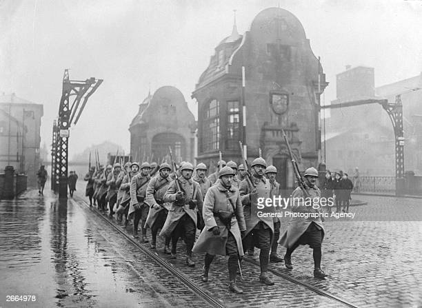 A group of French soldiers marching through Dusseldorf during the French occupation of the Ruhr