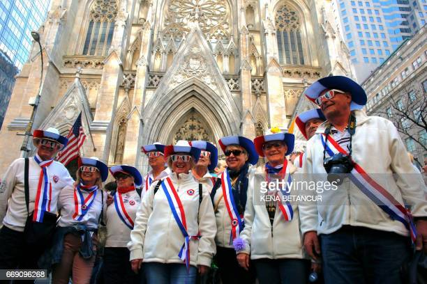 A Group of French Tourist pose for a picture in front of St Patrick's Cathedral as they attend the annual Easter Parade and Easter Bonnet Festival on...
