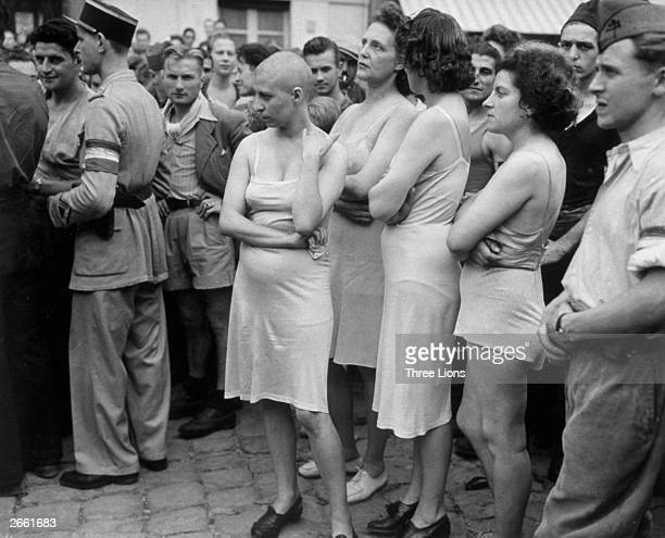 A group of Frenchwomen who had been accused of collaborating with the Germans stripped down to their underwear some with heads shaved as part of...