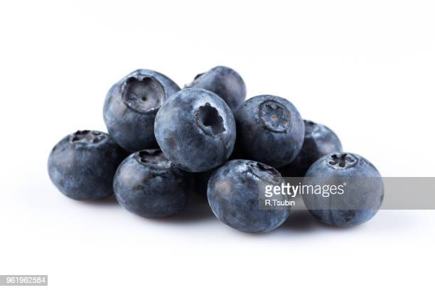 group of fresh juicy blueberries isolated on white background - ブルーベリー ストックフォトと画像