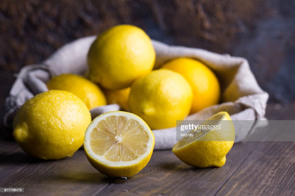 Group of fresh lemon on an old vintage wooden table : Stock Photo