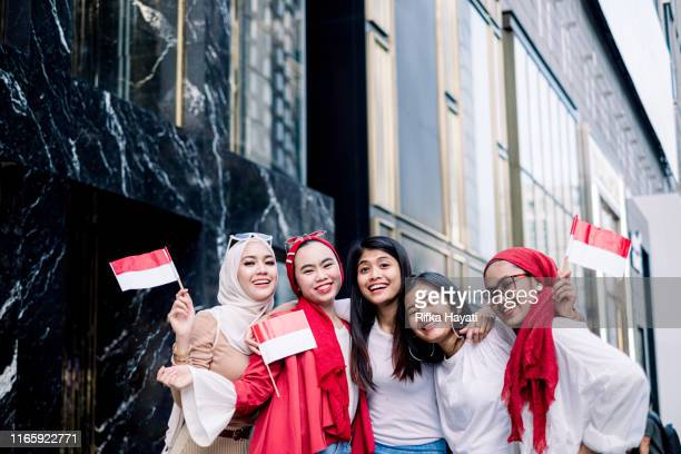 group of friend celebrating indonesian independence day - indonesia flag stock photos and pictures