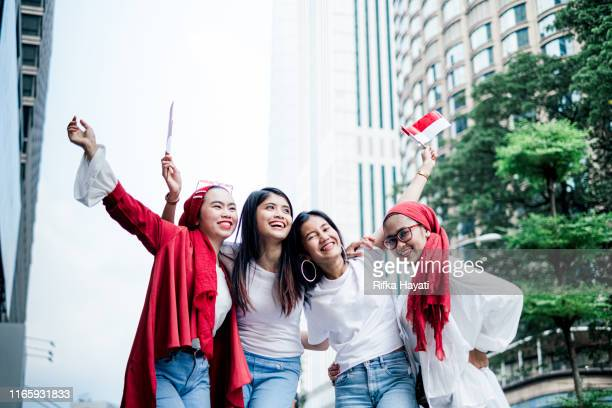 group of friend celebrating indonesian independence day - indonesian culture stock pictures, royalty-free photos & images