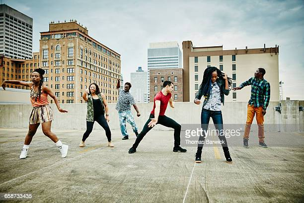 group of friend dancing on rooftop - memphis tennessee stock pictures, royalty-free photos & images