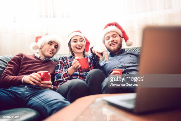 Group of Friend Drinking Hot Drink and Watching Movie for The Holidays