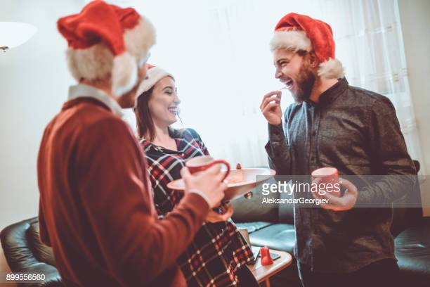 Group of Friend Eating Snacks and Having Fun for The Holidays