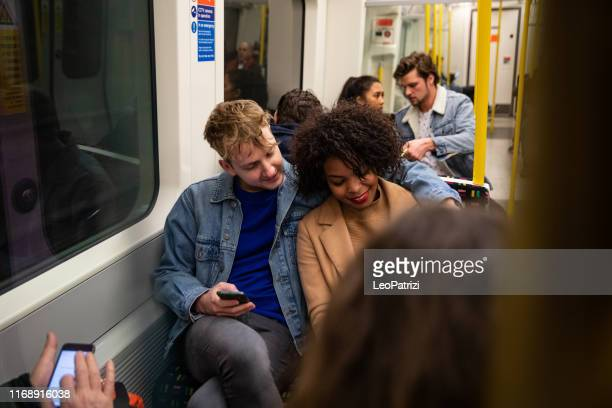 group of friend in the subway train - london underground stock pictures, royalty-free photos & images