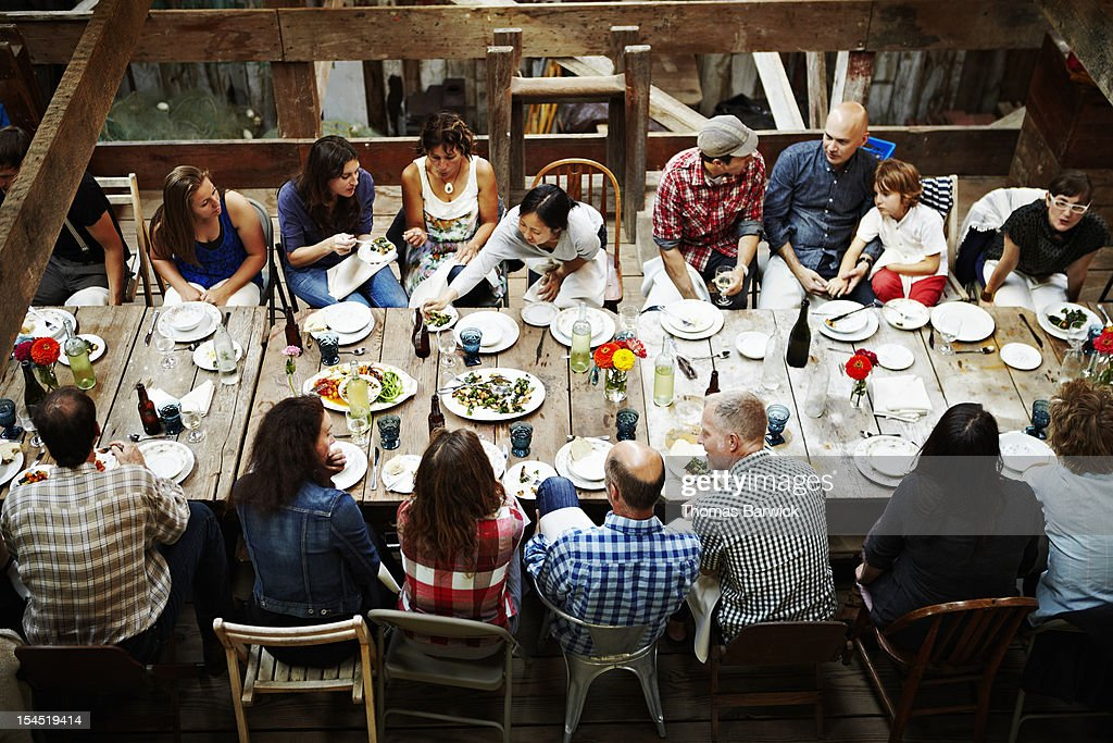 Group of friends and family dining overhead view : Stock Photo
