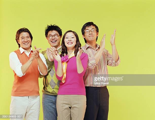 Group of friends, applauding, portrait