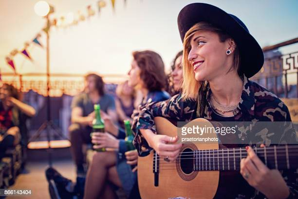 group of friends are celebrating with a concert on the roof terrace - of jazz musicians stock pictures, royalty-free photos & images