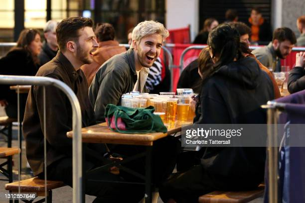 Group of friends are seen drinking and laughing in outdoor seating venues in Manchester's Northern Quarter on April 16, 2021 in Manchester, England....