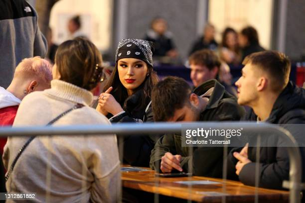 Group of friends are seen sat in a pubs outdoor seating area on April 16, 2021 in Manchester, England. Pubs and Restaurants are expecting good...