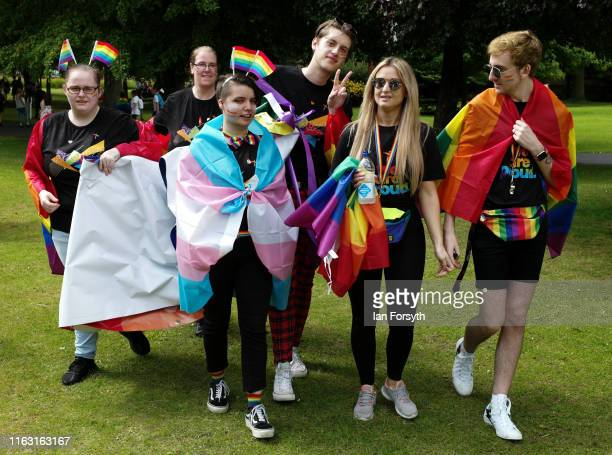 Group of friends arrive to take part in the Newcastle Pride Festival parade on July 20, 2019 in Newcastle upon Tyne, England. To commemorate 50 years...