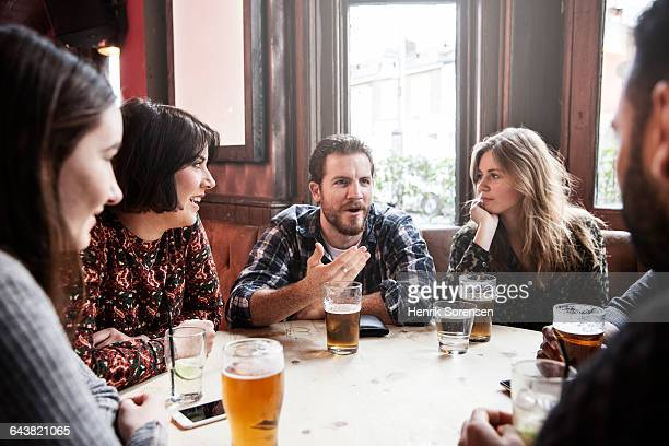 group of friends at a pub - pub stock pictures, royalty-free photos & images