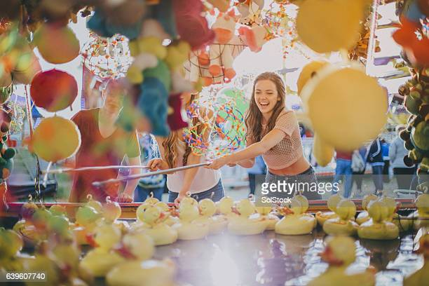 group of friends at carnival - petite teen girl stock photos and pictures