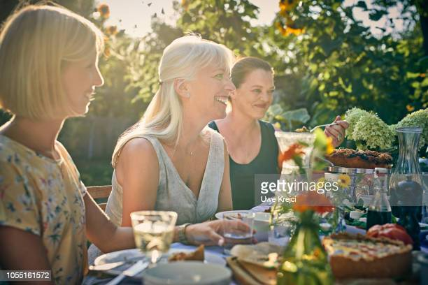 Group of friends at dinner party in garden