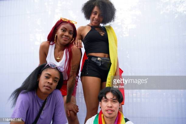 group of friends at pride event - parade stock pictures, royalty-free photos & images
