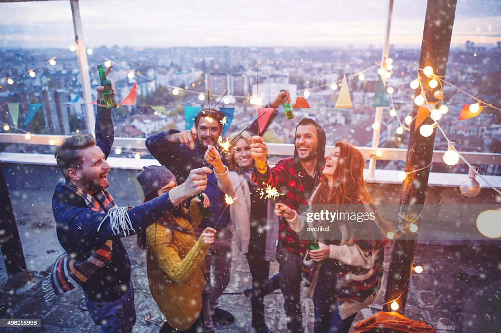 Group of friends at rooftop party : Stock Photo