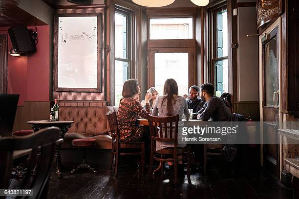 group of friends at the pub - pub stock pictures, royalty-free photos & images