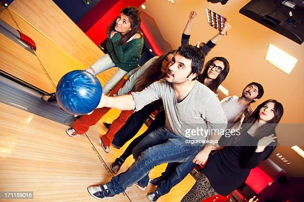 Group of friends bowling together and having fun