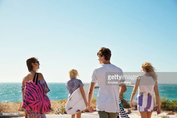 group of friends by the sea with surfboard - perth australia stock pictures, royalty-free photos & images