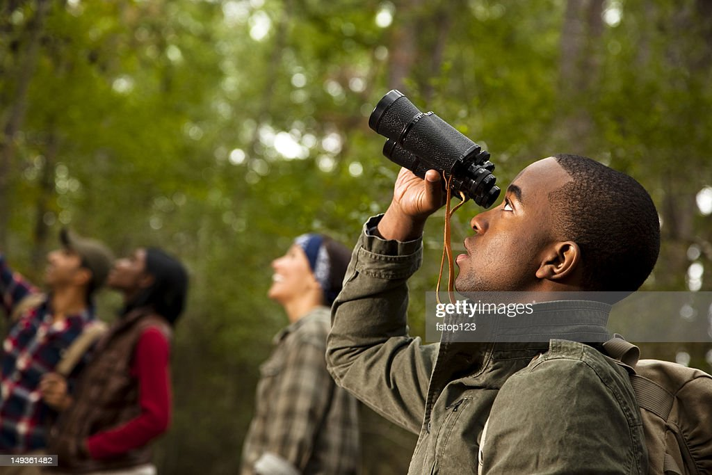 Group of friends camping and hiking using binoculars. Bird watching. : Stock Photo