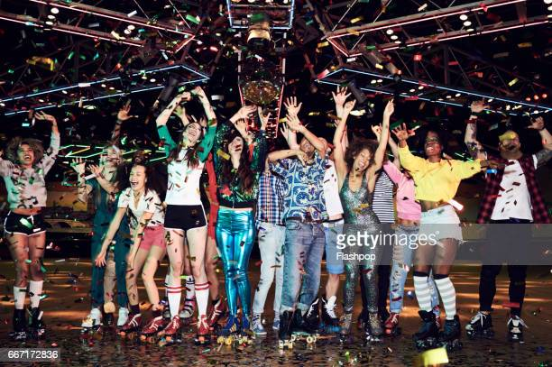 group of friends celebrating at roller disco - roller rink stock photos and pictures