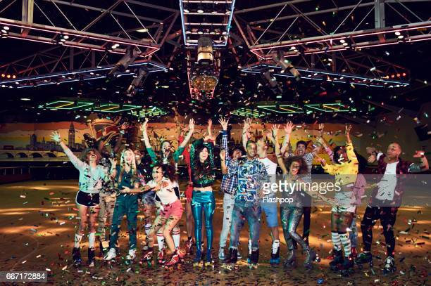 group of friends celebrating at roller disco - roller skating stock photos and pictures