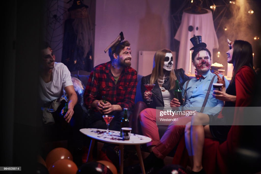Group of friends celebrating Halloween : Stock Photo