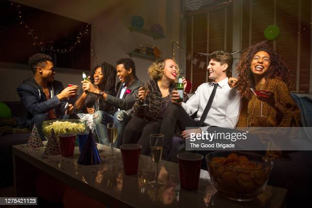 group of friends celebrating new years eve - 25 29 years stock pictures, royalty-free photos & images
