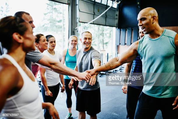 group of friends celebrating together in gym - sportkleding stock pictures, royalty-free photos & images