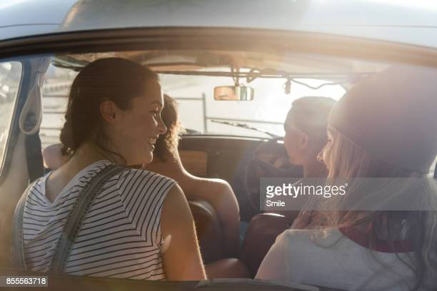 group of friends chatting in a car - four people stock pictures, royalty-free photos & images