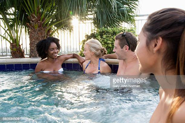Group of  friends chatting in outdoor spa
