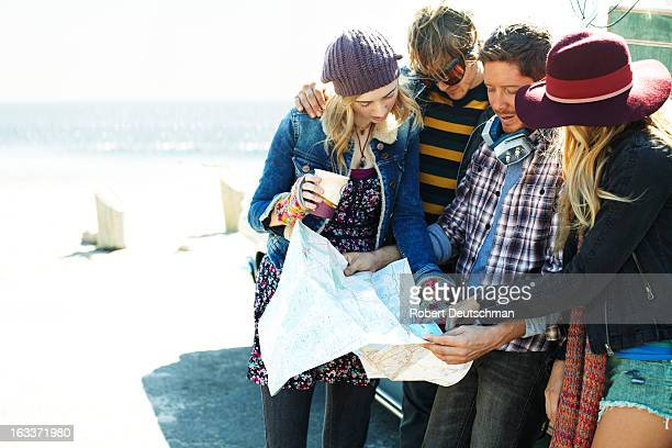 A group of friends consulting a map.