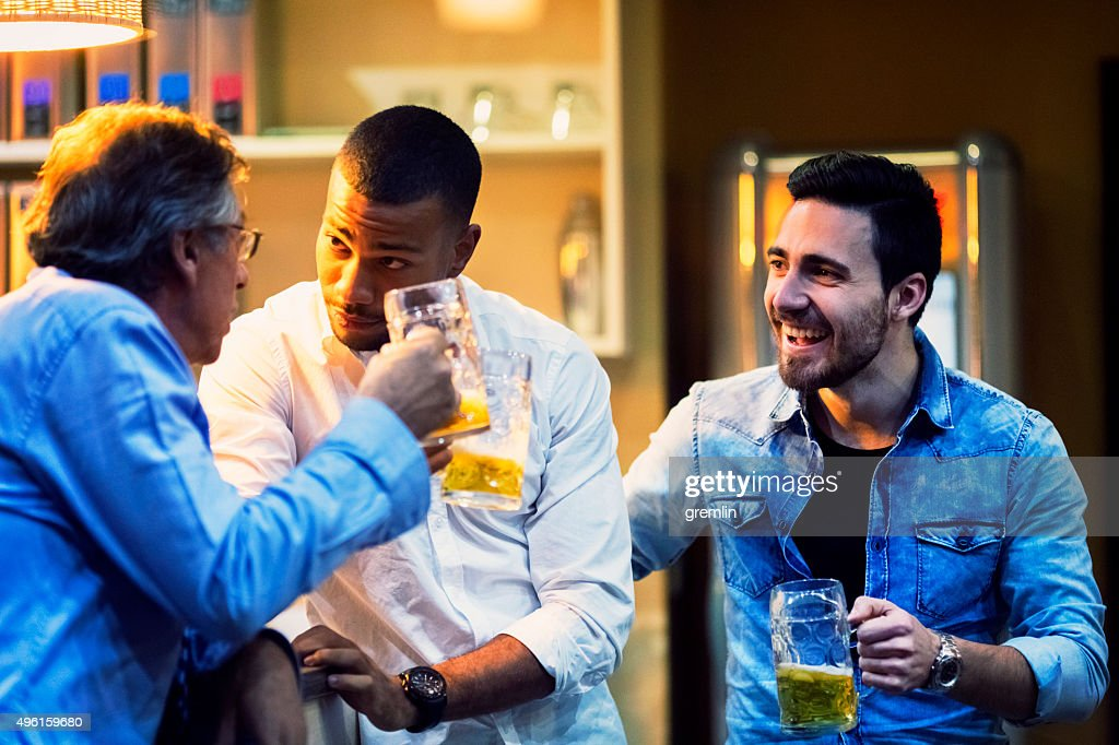 Group of friends, coworkers, drinking beer in the pub : Stock Photo