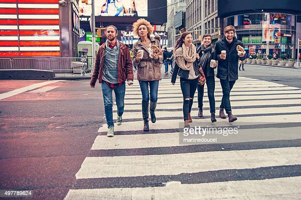 Group of friends crossing the street in New York.