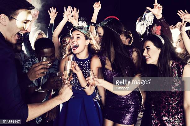 group of friends dancing and having fun together - asian drink stock photos and pictures