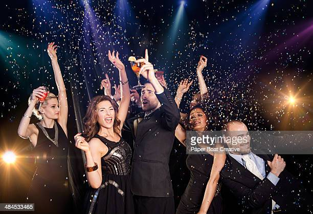 group of friends dancing at a new years party - 25 29 years stock pictures, royalty-free photos & images