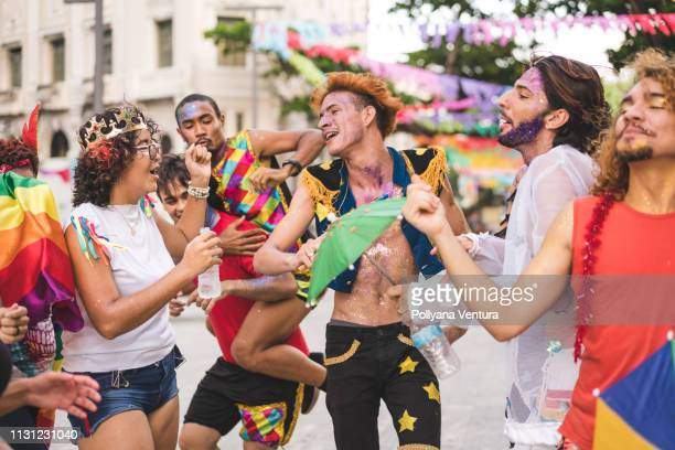 group of friends dancing on the street - lgbtqi pride event stock pictures, royalty-free photos & images