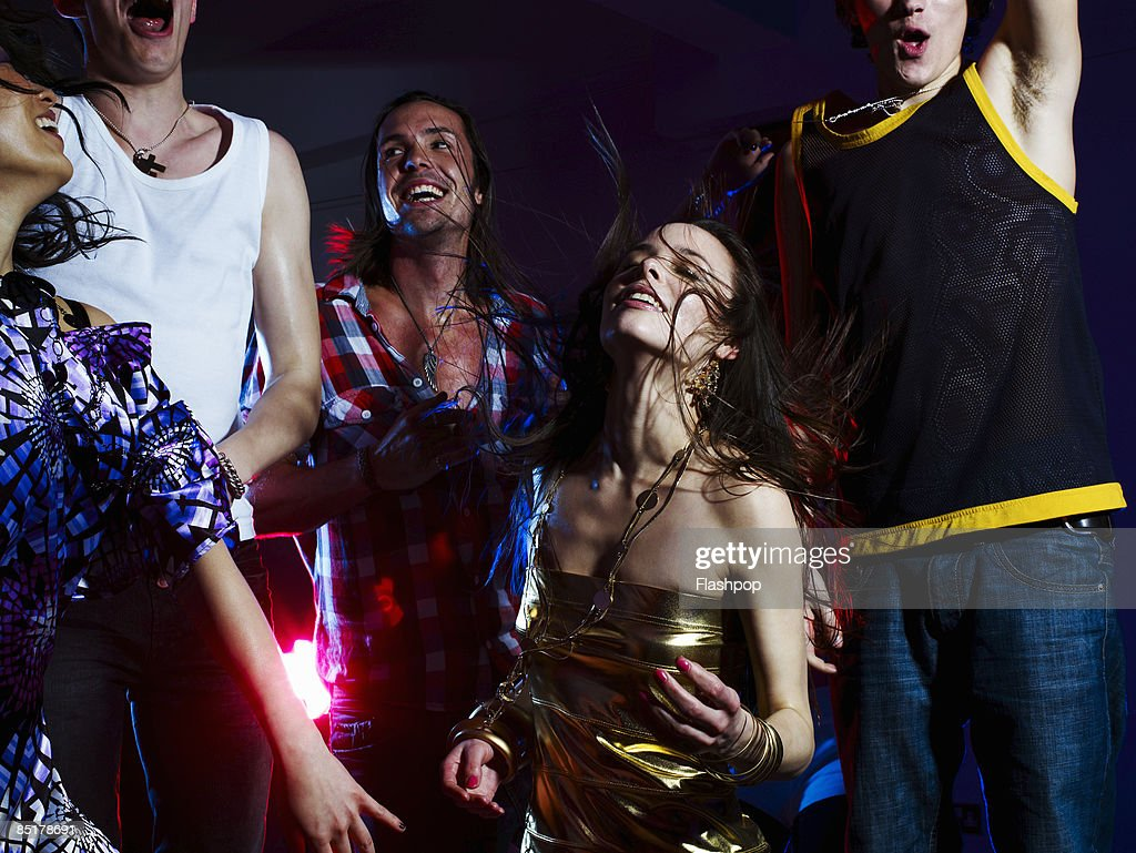 Group of friends dancing : Stock Photo